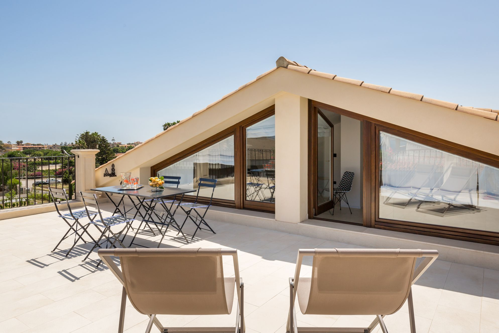 Roof top terrace on Villa Raphael with table and chairs for guests to eat