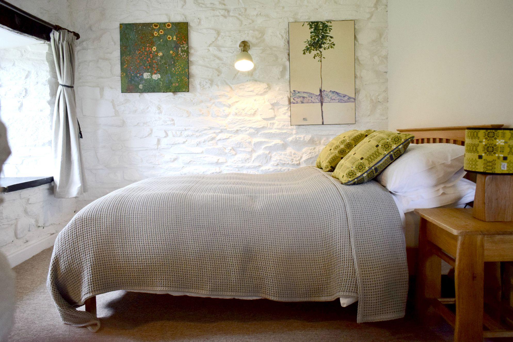 Cosy but rustic bedroom in The Tudor Kitchen in Newport