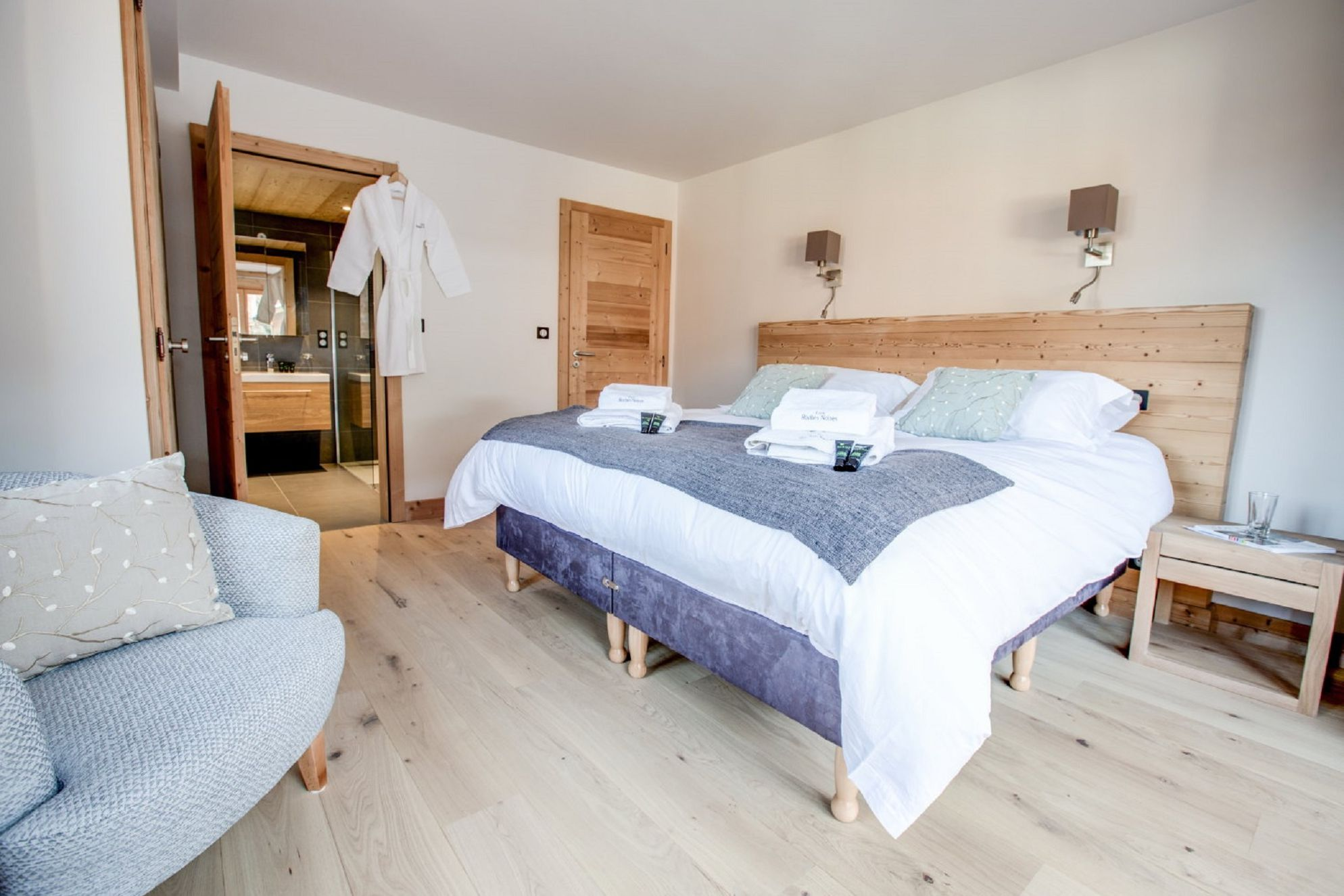 Modern bedroom with fluffy, complimentary robes in Les Roches Noires in Morzine, France