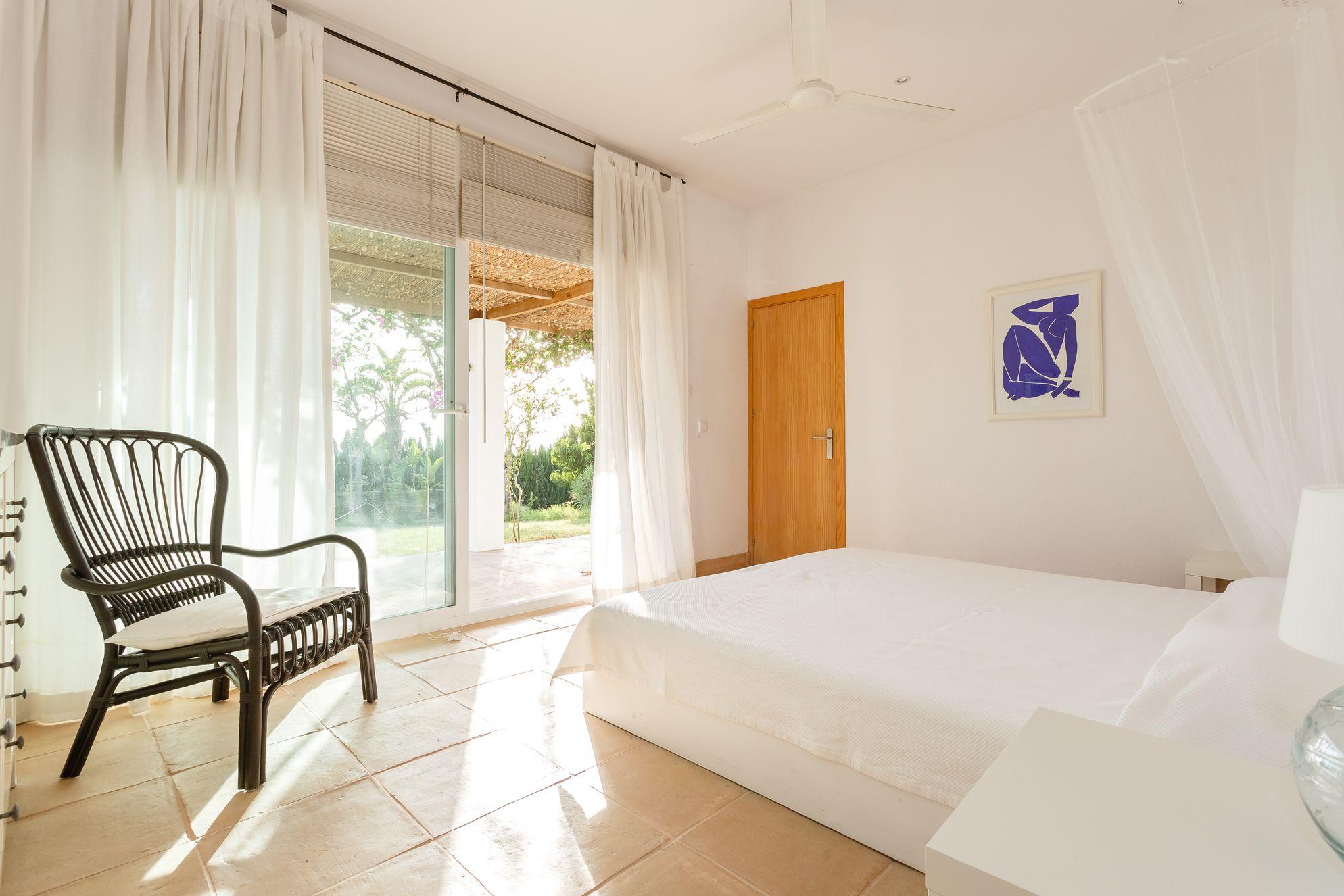 Simple, light-filled bedroom in El Martinete