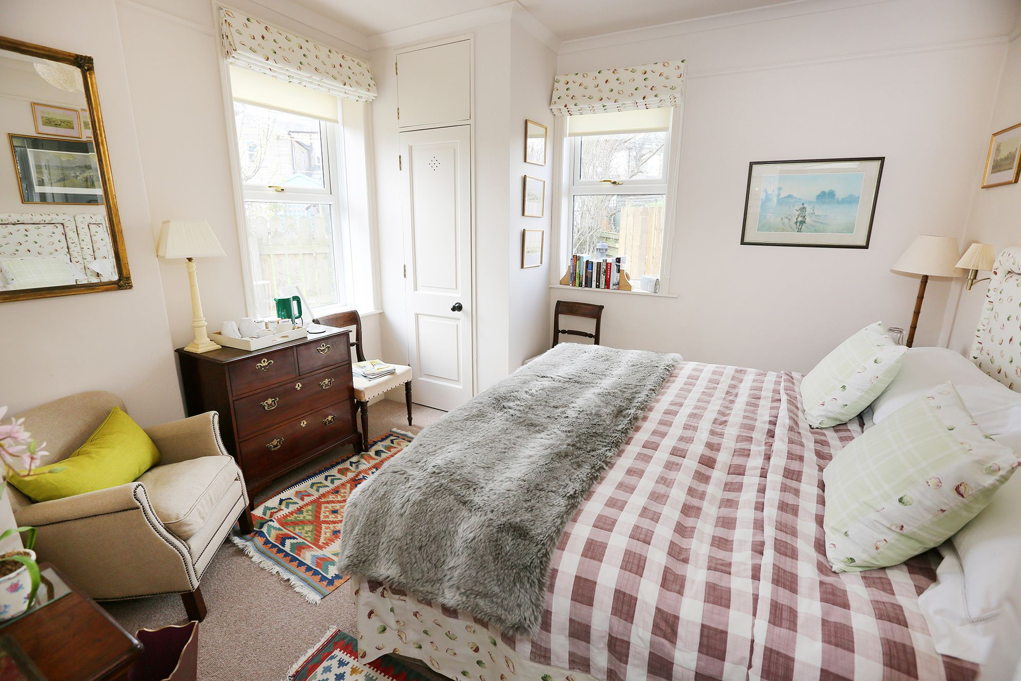 Double bedroom with a comfy armchair and a couple of chairs for relaxing in, as well as big windows letting lots of light in