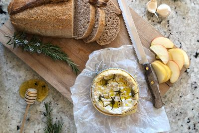 Homemade bread and baked Camembert