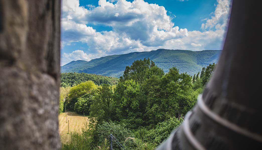 View from a hillside church across green fields