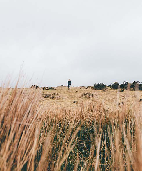 Lady wanders across Bodmin Moor Cornwall