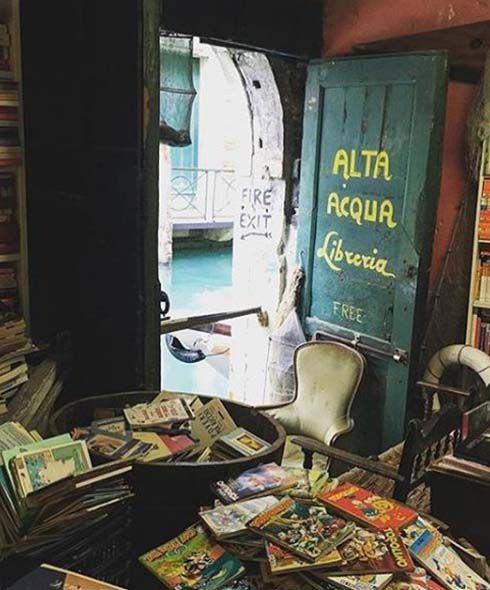 Eccentric bookshop overflowing with books in venice